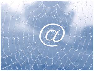 Spinnennetz mit @-Zeichen in der Mitte